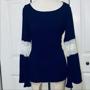 Pink peel pedant blouse in Navy with white lace